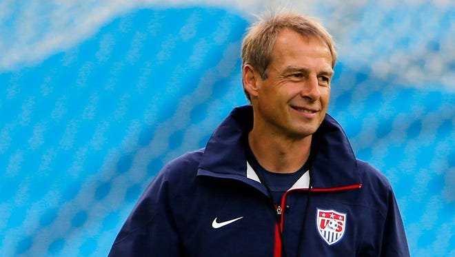 United States manager Jurgen Klinsmann smiles during their final training session before their opening World Cup game against Ghana at Estadio das Dunas.