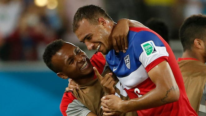 Jun 16, 2014; Natal, Rio Grande do Norte, BRAZIL; United States defenderJohn Brooks (6) is hugged by midfielder Julian Green (16) after his winning goal to beat Ghana 2-1 during their 2014 World Cup game at Estadio das Dunas. Mandatory Credit: Winslow Townson-USA TODAY Sports