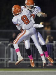 Central York's Eddie Santiago (8) and Ben Ward celebrate after a touchdown last season. Santiago returns as one of Central's receiving options.