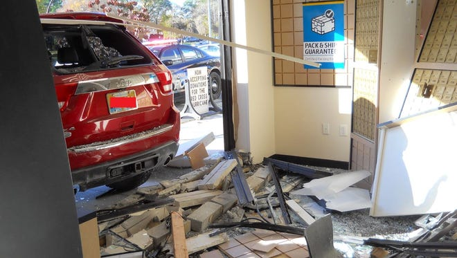 Livonia police provided this image with a redaction over the license plate of a vehicle that drove through the UPS Store on Seven Mile last weekend. No one was injured.