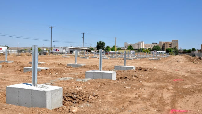 Concrete foundations await the installation of solar panels at the site of the San Juan Regional Medical Center's solar farm. The special anchoring system will be the largest of its kind in the world.