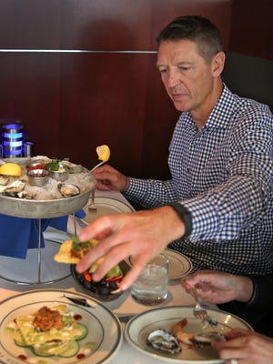 Former Pacers forward Detlef Schrempf eats some seafood appetizers at Oceanaire, Tuesday, November 1, 2016.  He strongly recommends a diet that includes seafood at least two times a week to make lifestyles more healthy.