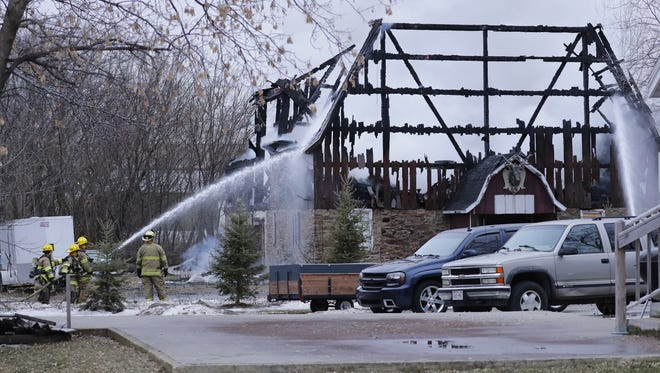 Firefighters extinguish a barn fire Tuesday at 1911 Winnebago County II in the Town of Neenah.