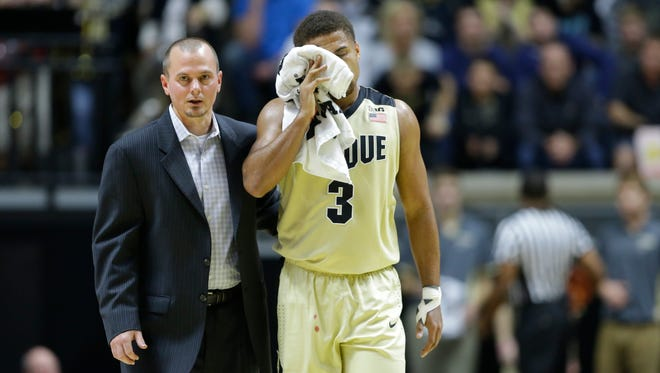 Purdue guard P.J. Thompson (3) walks off the court after being injured in the first half of an NCAA college basketball game against Youngstown State in West Lafayette, Ind., Saturday, Dec. 12, 2015. (AP Photo/Michael Conroy)