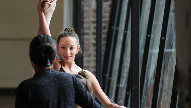 Keira Bordenkircher and other members of the Fleur-De-Lis Academy warm up before auditions for the Moscow Ballet's Nutcracker.