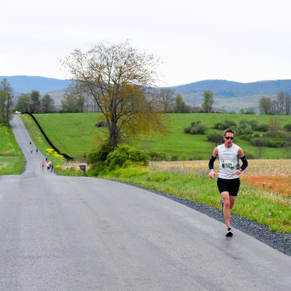 Ethan Cempe of Raphine races along Hall School Road.