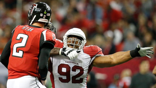 Arizona Cardinals nose tackle Dan Williams (92) applies pressure to Atlanta Falcons quarterback Matt Ryan (2) during the second half of an NFL football game, Sunday, Nov. 30, 2014, in Atlanta.