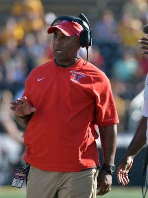 Delaware State Hornets head coach Kenny Carter watches play on the sidelines during the first half against the Missouri Tigers at Faurot Field.