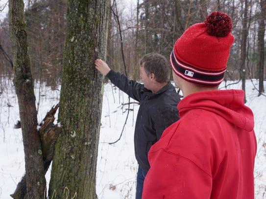 Mesoraco and Marucci Sports logger Olen Tucker inspect