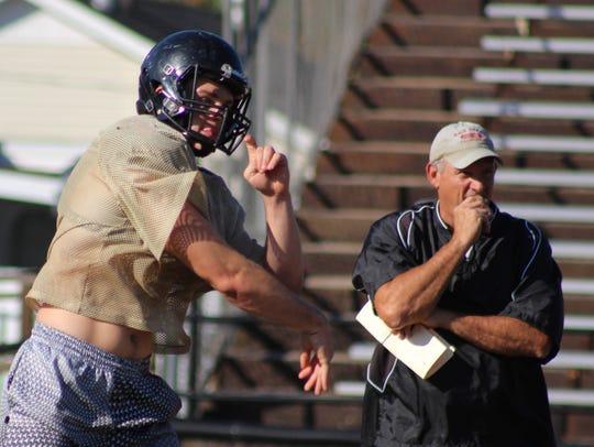 Wayne County quarterback Preston Rice, left, has thrown