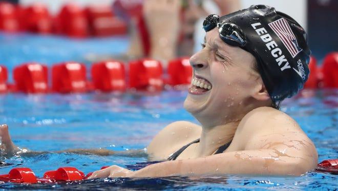 Katie Ledecky celebrates after winning the women's 800-meter freestyle final.