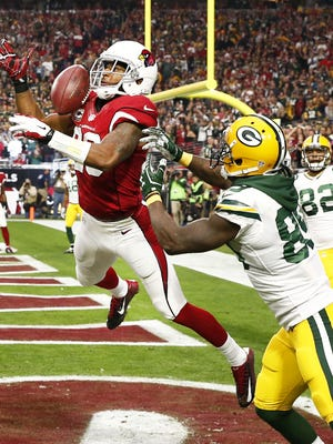 Arizona Cardinals' Justin Bethel intercepts the pass away from Green Bay Packers' James Jones in the end zone in the second half on Dec. 27, 2015 in Glendale, Ariz.