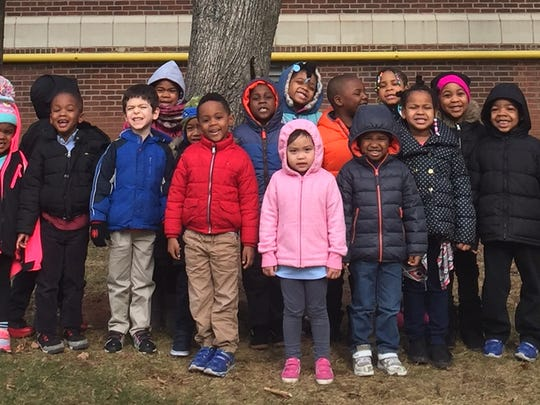 "Students in Vanessa Vasquez's Pre-K class at School No. 5 in Linden pose for a picture in front of their ""Adopted Tree"". Students observe their tree once a month during their Science block and write about what they have observed. They also use this opportunity to work toward their end of the year Science Journal."