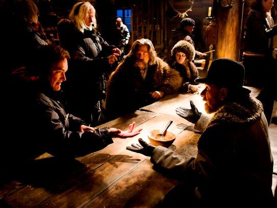 Quentin Tarantino (far left) directs a scene with Kurt