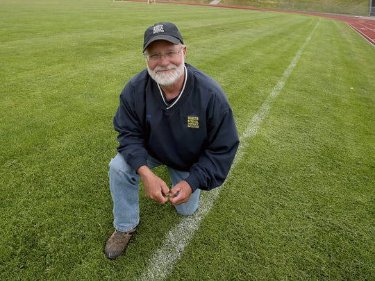 In addition to being the head groundskeeper for the Bremerton School District, Lance McCoy is a longtime coach of the high school's girls soccer team.