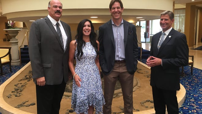 Four of the five inductees into the Ventura County Sports Hall of Fame: Steve Ornelaz, left to right, Laurie Singer, Scott Fujita and Mark Cleavenger. Jack Wilson was unable to attend Sunday's banquet.