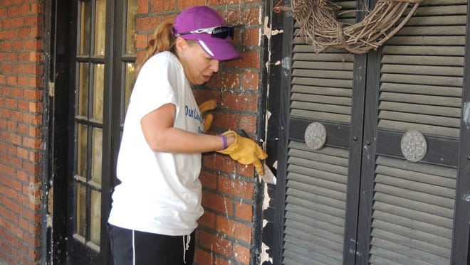 Volunteers helped fix up senior citizens' homes in University City, Mo., for Make A Difference Day.