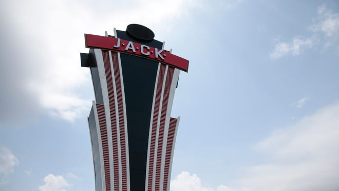 Workers changed the signage of the former Horseshoe Casino Cincinnati to Jack Casino on May 26.