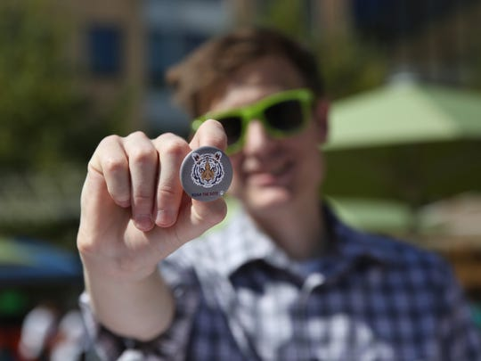 Cory Meyer of Cleveland, a fourth-year student, holds up a Roar the Vote button he was handing out at the voter registration information table at RIT's Global Village on Wednesday, Sept. 21, 2016 in Henrietta.