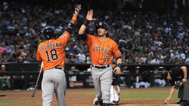 Astros left fielder Colby Rasmus high-fives third baseman Luis Valbuena after hitting a home run against the Diamondbacks.