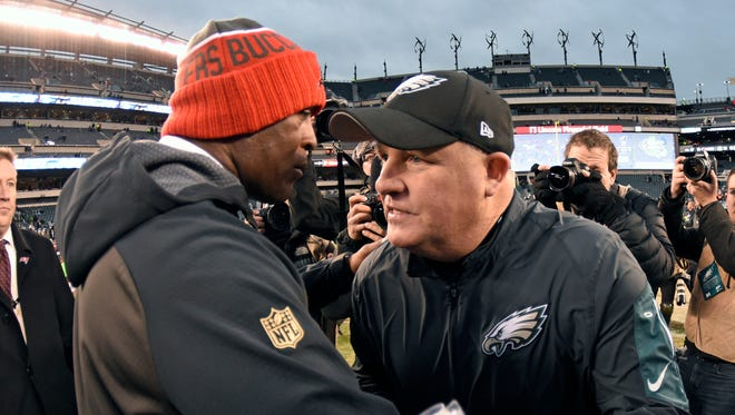 Nov 22, 2015; Philadelphia, PA, USA; Tampa Bay Buccaneers head coach Lovie Smith and Philadelphia Eagles head coach Chip Kelly meet on field after game at Lincoln Financial Field. The Buccaneers defeated the Eagles, 45-17.