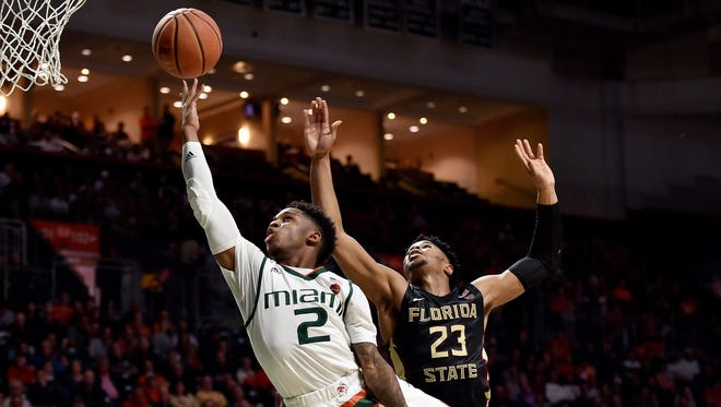 Miami Hurricanes guard Chris Lykes (2) shoots the ball past Florida State Seminoles guard M.J. Walker (23) during the second half at Watsco Center.