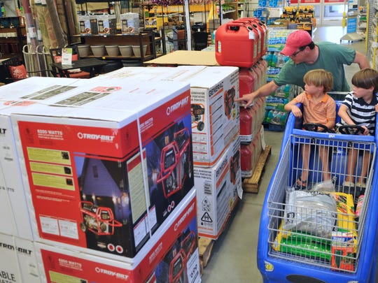 Ron Arthur and his sons Xander, 5, and Mason, 7, shop through the Lowe's Home Improvement store in Indian Harbour Beach on Friday. That generator that caught their eye is on the list of approved tax-free purchases between now and 11:59 p.m. June 8.