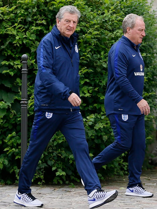 England manager Roy Hodgson, left, and  assistant manager Ray Lewington walk outside the team hotel in Chantilly, France, Monday, June 13, 2016. England will face Wales in a Euro 2016 Group B soccer match in Lens on Thursday, June 16. (AP Photo/Kirsty Wigglesworth)