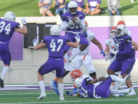 ACU's Temisan Kuyatsemi intercepts a Jeremiah Briscoe pass in the third quarter. It gave ACU the ball at the Bearkats' 10-yard line and set up a 10-yard TD pass to Troy Grant to cut SHSU's lead to 31-14 with 10:09 left in the quarter. No. 4 Sam Houston beat ACU 44-35 on Saturday, Nov. 11, 2017 at Wildcat Stadium.