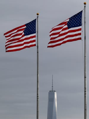 United States flags fly at Liberty State Park with 1 World Trade Center in the background, Thursday, Sept. 11, 2014, in Jersey City, N.J. The country is observing the 13th anniversary of the Sept. 11, 2001 terrorist attacks on the World Trade Center.