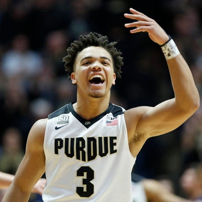Carsen Edwards waves to the Paint Crew after Purdue