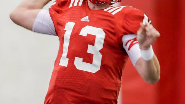 In this Saturday, March 11, 2017, photo, Nebraska quarterback Tanner Lee (13) throws during NCAA college football spring practice in Lincoln, Neb. The Huskers' competition is maybe most notable because they haven't really had one is such a long time. The leading candidates to replace four-year starter Tommy Armstrong are traditional pocket passers that should, theoretically, be a more natural fit to coach Mike Riley's offense. (AP Photo/Nati Harnik)