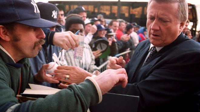 George Steinbrenner signs autographs as he enters Yankee Stadium for the 1993 home opener. Steinbrenner was known for being a shrewd owner, but he was always fan-friendly.