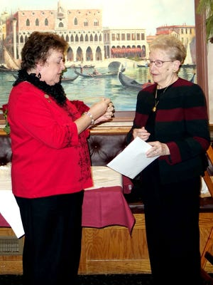 Norene Ritter (left) presents Joyce Prochaska with her 50-year pin for membership in the Woman's Club of Vineland.