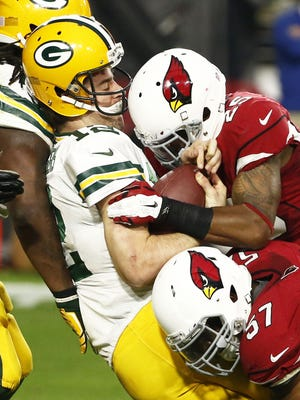 Arizona Cardinals Jerraud Powers (25) hits and sacks Green Bay Packers quarterback Aaron Rodgers in the second half on Dec. 27, 2015 in Glendale, Ariz. Jerraud Powers was called for helmet-to-helmet contact.