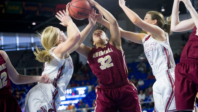Riverdale's Brinae Alexander grabs a rebound as Morristown West's Sydney Newsmen, left,  and Hannah Shultz reach for the ball during the quarterfinals of the Class AAA state girls basketball tournament at the Murphy Center in Murfreesboro on Wednesday.