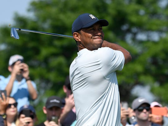 Tiger Woods hits his tee shot on the 4th hole during the first round of The Northern Trust golf tournament at Liberty National Golf Course. Mandatory Credit: Mark Konezny-USA TODAY Sports