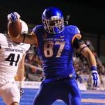 Boise State tight end Alec Dhaenens (87) scores during against Utah State last season.