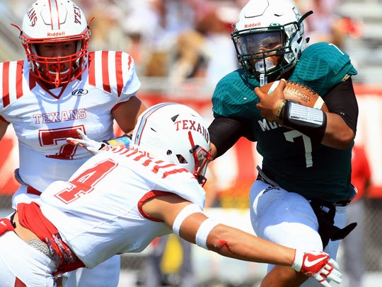 King's Elijah Flowers runs past Ray players on Friday,