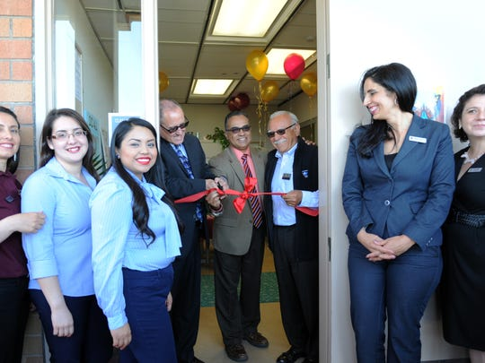 Hartnell administrators cut the ribbon opening the school's new Center for Achievement and Student Advancement (Mi CASA) on Wednesday.