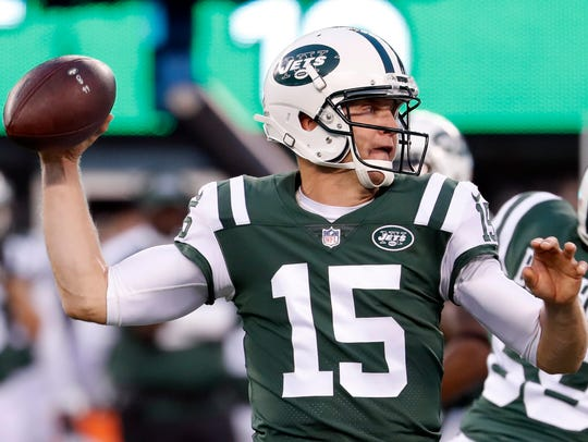 New York Jets quarterback Josh McCown looks to pass