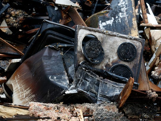 The remains of a stove are seen at a house that caught fire on New Year's Day in Bolivar, killing two men.