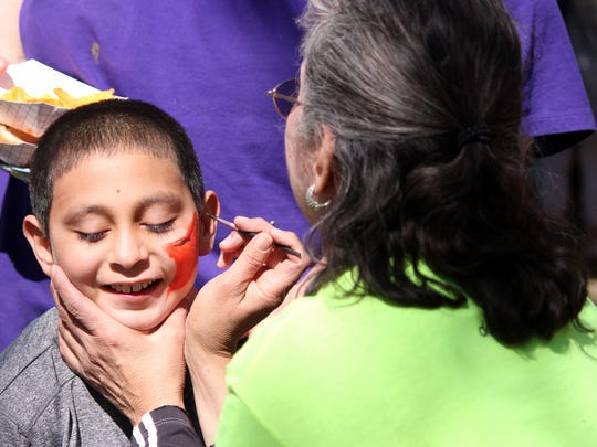 Angel Almanza, 11, gets his face painted at the Eater Egg hunt Saturday. Face painting was one of many activities for children to be involved with during the Community Easter Egg Hunt at Courthouse Park.