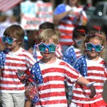 Kids march during First Baptist Church Weekday Education's annual 4th of July parade, in Oxford, Miss.