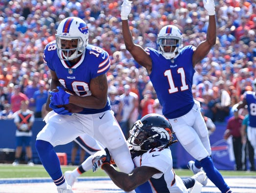 Buffalo Bills wide receiver Andre Holmes scores a touchdown