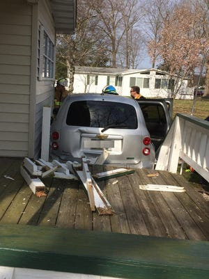 Debris from a shattered handrail lies on a deck after a car hit it on Thursday.