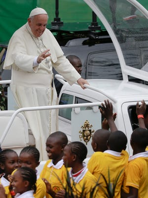 "Pope Francis arrives on his popemobile to celebrate a Mass on the campus of the University of Nairobi, Kenya, Thursday, Nov. 26, 2015. Pope Francis told Christian and Muslim leaders in Kenya on Thursday that they have little choice but to engage in dialogue to guard against the ""barbarous"" Islamic extremist attacks that have struck Kenya. (AP Photo/Andrew Medichini)"