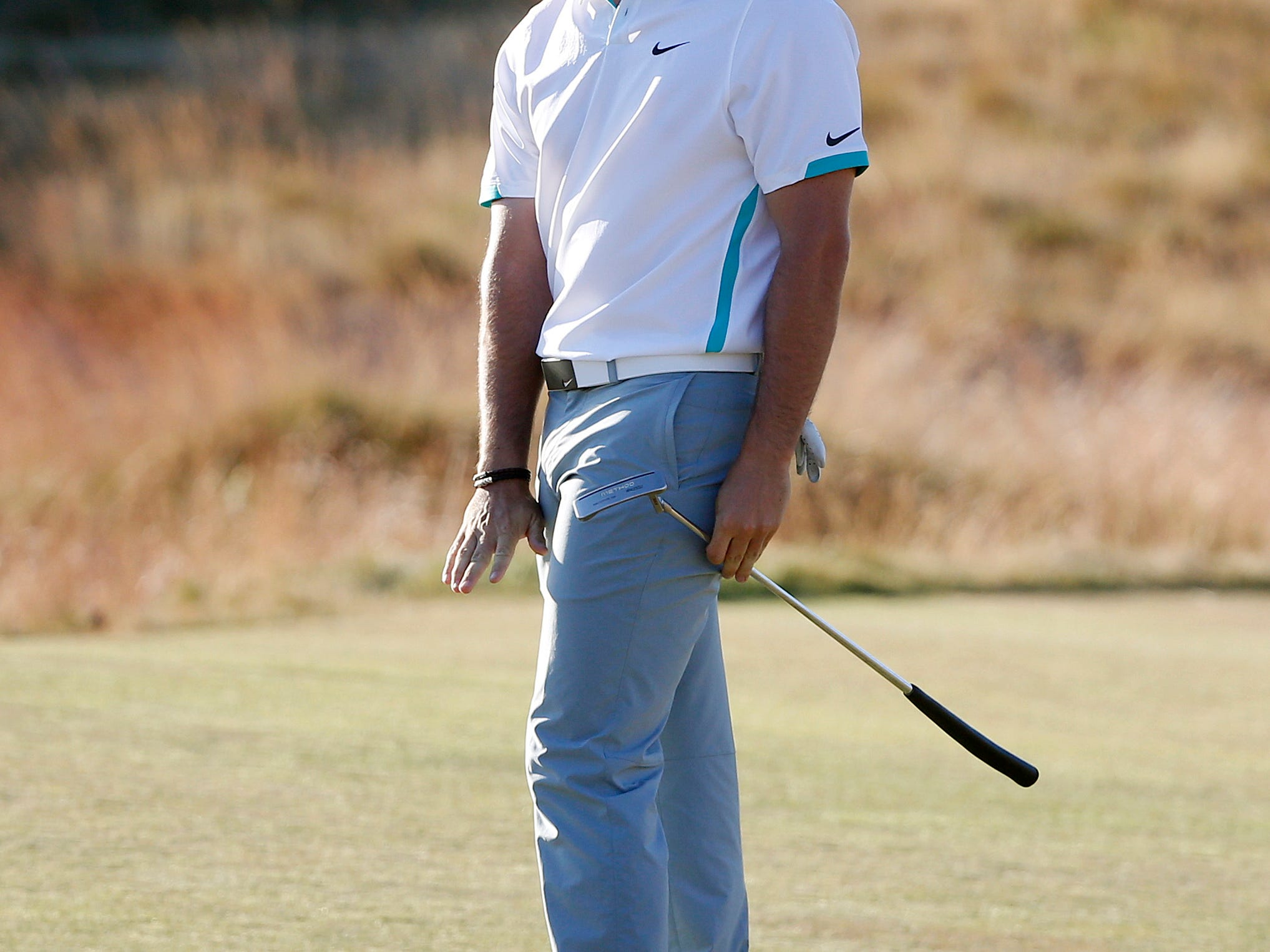 Rory McIlroy, of Northern Ireland, reacts to his putt on the 18th hole during the second round of the U.S. Open golf tournament at Chambers Bay on Friday, June 19, 2015 in University Place, Wash. (AP Photo/Lenny Ignelzi)