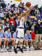 Oconomowoc senior Dominic Briggs (21) goes up for three during the game at home against Arrowhead on Friday, Dec. 8.