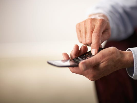 Senior man using mobile phone, close-up of hands